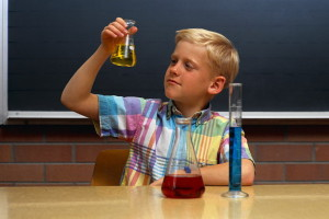Young Boy Inspects Liquid in a Flask